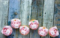 Pig cupcakes, animal shaped funny cakes for kids. Party, piggy cupcakes with pink frosting and marshmallow stock image