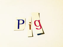Pig - Cutout Words Collage Of Mixed Magazine Letters with White Background. Caption composed with letters torn from magazines with White Background Royalty Free Stock Photo