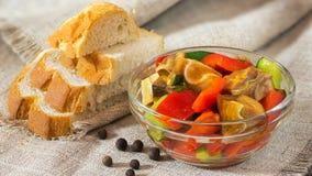Pig ears salad, white bread, black pepper Stock Image