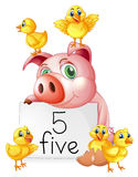 Pig and five little chicks Stock Images