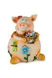 Pig with flowers. Isolated on white, clipping path Royalty Free Stock Image