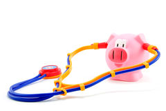 Pig flu with stethoscoop. Pig flu with stethoscope isolated on white background royalty free stock photo