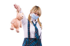 Pig flu virus.Schoolgirl with mask is afraid pig Stock Photography