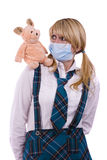 Pig flu virus.Schoolgirl with mask is afraid pig Royalty Free Stock Photo