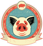 Pig head label on old paper texture. Royalty Free Stock Image