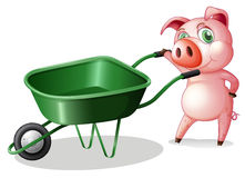 A pig holding a wheelbarrow Royalty Free Stock Photos
