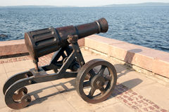 Pig-iron gun on Lake Onega Royalty Free Stock Image