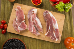 Pig loin raw in wooden background Royalty Free Stock Photo