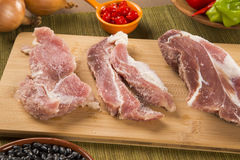Pig loin raw in wooden background Royalty Free Stock Image