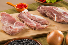 Pig loin raw in wooden background Royalty Free Stock Photos