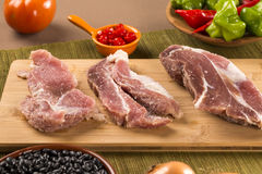 Pig loin raw in wooden background Royalty Free Stock Photography