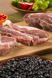 Pig loin raw in wooden background Stock Photos