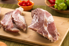 Pig loin raw in wooden background Stock Photo