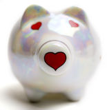 Pig of love. Cute ceramic piggy bank with hearts instead of the eyes and nose Royalty Free Stock Photography