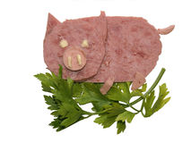 The pig, made from the pieces of a ham. Isolated on white Stock Images