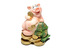 Pig with money. Ceramic piggy with money isolated on white background Stock Images