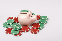 Pig money box with casino chips over white Stock Photography