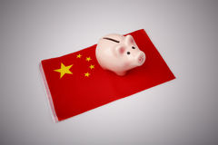Pig money box and China flag Stock Photography