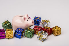 Pig money box between christmas gift Stock Photo