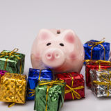Pig money box between christmas gift Royalty Free Stock Images