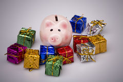 Pig money box between christmas gift royalty free stock image