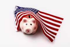 Pig money box and USA flag Royalty Free Stock Photo