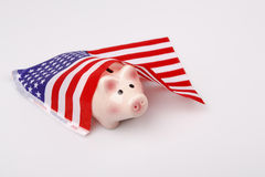 Pig money box and USA flag Stock Images