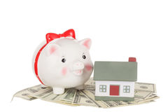Pig moneybox. Cash and house. Concept of accumulation of money for purchase or rent Royalty Free Stock Images