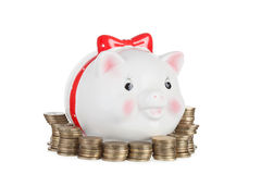 Pig moneybox and gold coins Royalty Free Stock Photo