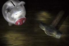 Pig moneybox and hummer Royalty Free Stock Images