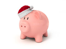 Pig piggy bank in a Christmas hat Stock Image