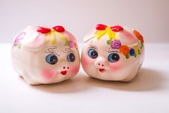 The pig piggy bank. Porcelain painted money pig, piggy bank Royalty Free Stock Photography