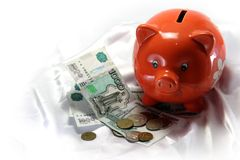 Pig piggy bank. On a white silk background Stock Photography