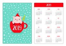 Pig piggy in red coffee tea cup. Santa hat, snow. Simple pocket calendar layout 2019 new year. Week starts Sunday. Cute cartoon royalty free illustration