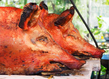 Pig roast in a street market Stock Photo