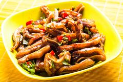 Pig's ear. A Chinese spicy food in a bowl royalty free stock photo