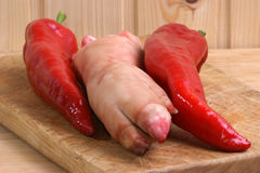 Pig's trotter and red pepper. To make a soup Royalty Free Stock Photos