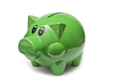 Pig shaped money box. Green pig shaped money box Royalty Free Stock Photos