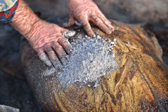 Pig skin being washed with ash after being slaughtered Stock Photos