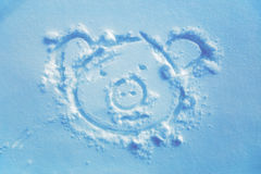 Pig in snow, drawing in the snow. Light blue background. Royalty Free Stock Photo
