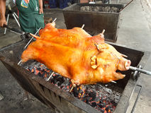 Pig on spit, roasted pork Stock Photography