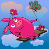 Pig swinging in sky with clouds.s Royalty Free Stock Photos