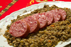 Pig trotter with lentils. On white dish Royalty Free Stock Image