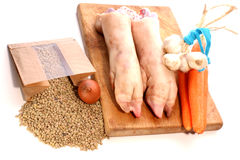 Pig trotter, lentils and vegetables Stock Images