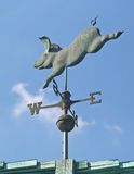 Pig Weather Vane. A Pig Weather Vane on a roof with blue sky stock photography
