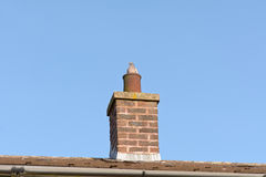 Pigeon (Columbidae) sitting in chimney pot on roof of house Stock Photos