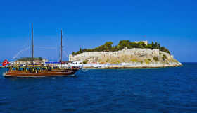Pigeon Island, Kusadasi, Turkey. Pigeon Island is a small island located in the Kusadasi harbor, on the Aegean coast of Turkey. The Byzantine castle standing on Stock Photo