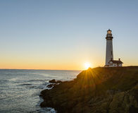 Pigeon Point lighthouse at sunset Royalty Free Stock Photos