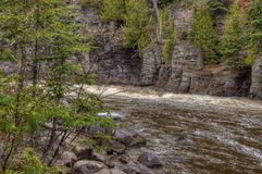 The Pigeon River flows through Grand Portage State Park and Indian Reservation. It is the Border between Ontario and Minnesota stock photography