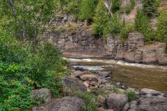 The Pigeon River flows through Grand Portage State Park and Indian Reservation. It is the Border between Ontario and Minnesota royalty free stock photography